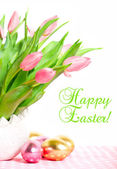 Pink spring tulips with easter eggs — Stock Photo