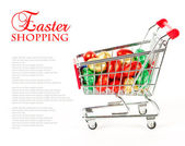 Colorful eggs in a shopping cart — Stock Photo
