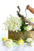 Easter decoration with eggs and lily of the valley flowers — Stock Photo