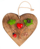 Wooden heart with symbols of luck — Stock Photo