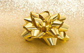 Golden bow on shiny background — Foto Stock
