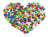 Confetti in heart shape. colorful background — Stock Photo