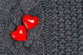 Red hearts of knitted wool — Stock Photo