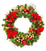Christmas wreath with poinsettia flowers — Stock Photo