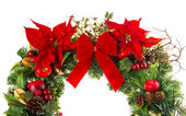 Close-up of christmas wreath with poinsettia flowers — Stock Photo