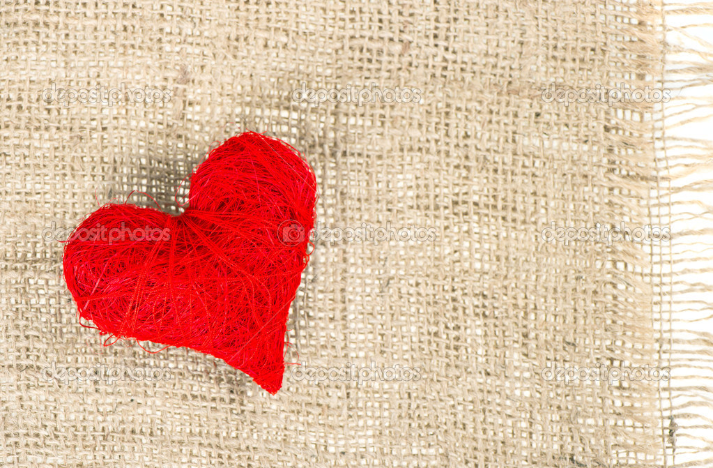 Red heart on burlap background  Stock Photo #13404734