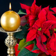 Red christmas star with golden candle — Stock Photo #13410602