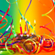 Birthday cupcake with candles and colorful streamer decoration — Stock Photo