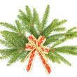 Stock Photo: Branch of christmas tree with red ribbon. christmas and new year