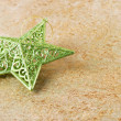 Stock Photo: Green shiny star on golden background