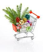 Winkelwagen met kerstboom decoratie — Stockfoto