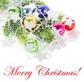 Veelkleurige kerstballen en zilveren garland — Stockfoto