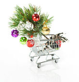 Shopping cart with colorful christmas tree decoration — Stockfoto