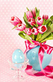 Spring tulip flowers with ceramic easter egg — Stock Photo