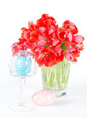 Red tulips and ceramic easter eggs — Stock Photo