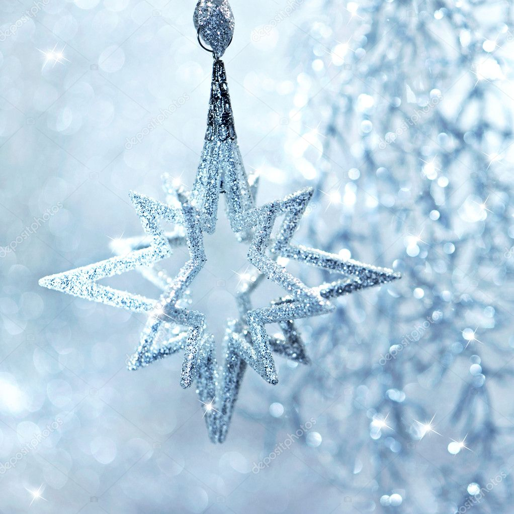 Blue shiny star. christmas or new year decoration. abstract background — Stock Photo #13410579
