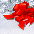 Christmas gift on silver shiny background — Stock Photo #13421802