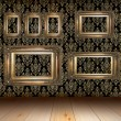 Old grunge interior with golden frames — Stock Photo
