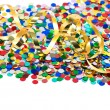 Colorful confetti background with golden streamer — Stock Photo