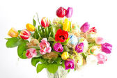 Multicolor fresh spring tulips with easter eggs — Stock Photo