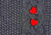Red hearts of knitted wool background — Stock Photo
