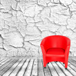 Red chair, white cracked wall and wooden floor — Stock Photo