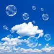 Soap bubbles on cloudy blue sky — Foto Stock