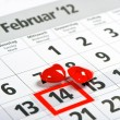Calendar with red mark on 14 February and red hearts decoration — Stock Photo