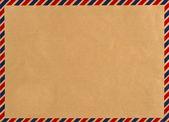 Envelope de correio aéreo vintage. fundo sujo — Fotografia Stock