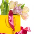 Fresh spring tulips with colorful decoration - Stock Photo