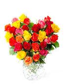 Boeket kleurrijke geassorteerde rozen in hart vorm — Stockfoto