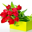 Fresh red tulips in the green gift box — Stock Photo