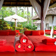 Spa massage bed with red towels — Foto de Stock
