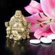 Buddha with stones and lily flower - Stock Photo