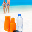 Stock Photo: Sun protection cream, water and sun glasses