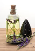 Herbal lavender oil with incense stick — Stock Photo