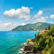 Beautiful mediterranean landscape with cloudy blue sky - Stock Photo