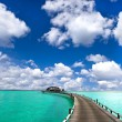 Tropical seascape. overwater bungalow — Stock Photo #13766613