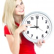 Photo: Young womholding clock. time management concept
