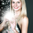 Young woman with magic shine — Stock Photo #13860988