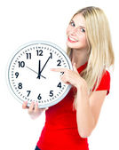 Young woman holding a clock. time management concept — Foto Stock