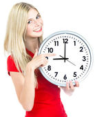 Young woman holding a clock. time management concept — Stok fotoğraf