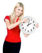 Young woman holding a clock. time management — Stok fotoğraf