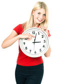 Young woman holding a clock. time management concept — Stockfoto