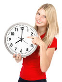 Time concept. young beautiful woman holding big clock — Fotografia Stock