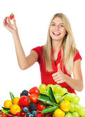Young beautiful woman with fresh fruits and berries — Stock Photo