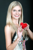 Pretty young woman with red heart — Stock Photo