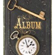 Stock Photo: Vintage poetry album with ild key and clock