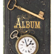 图库照片: Vintage poetry album with ild key and clock