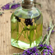 Essential lavender oil with fresh flowers — Stock Photo #13990469